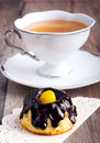 Small bundt cake with chocolate glaze and candied lemon and cup of tea Stock Photography