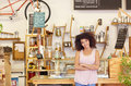 Small business owner standing proudly in her coffee shop Royalty Free Stock Photo