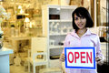 Small business owner: woman holding an open sign Royalty Free Stock Photos