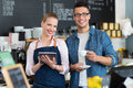 Small business owners in coffee shop Royalty Free Stock Photo