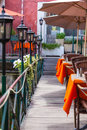 Small cafe with wicker furniture and umbrellas on a bridge Royalty Free Stock Photo