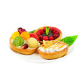 Small cakes with fruit and cream Stock Images