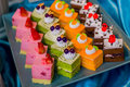 Small cakes on a square tray restaurant Stock Photography
