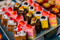 Small cakes on a square tray restaurant Royalty Free Stock Photo