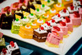 Small cakes on a square tray restaurant Royalty Free Stock Photos