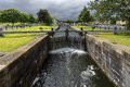 Small canal navigable, river barges to runoff, Scotland Royalty Free Stock Photo
