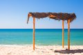 Small canopy at empty tropical beach on the Royalty Free Stock Photo