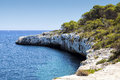Small cape rocky with trees in majorca spain Stock Photos