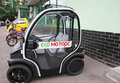 Small car moscow russia june double electric eco motors parked near the store on the sidewalk Royalty Free Stock Images