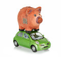 Small car with piggy bank on the roof green an Stock Images