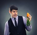 Small carrot in hands Stock Photography