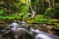 Small cascading waterfall in a creek taken in biei japan Royalty Free Stock Image
