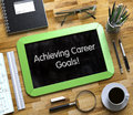Small Chalkboard with Achieving Career Goals Concept. 3D.