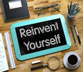 Small Chalkboard with Reinvent Yourself. 3d. Royalty Free Stock Photo