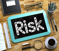 Small Chalkboard with Risk. 3D. Royalty Free Stock Photo