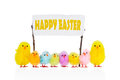 Small chickens wishes happy easter colorful standing with an sign with a message Royalty Free Stock Photos