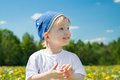 Small child the boy plays on a green meadow Royalty Free Stock Photo