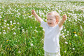 Small child the boy plays on a green meadow with dandelions Royalty Free Stock Photo