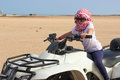 Small child in head kerchief on quadbike Stock Photography