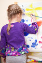 Small child painting with brush and paint caucasian rear view Royalty Free Stock Photo