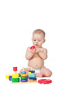 Small child play with toys on white background Royalty Free Stock Photos