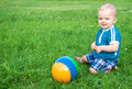 Small child the plays on a green summer meadow Stock Photography