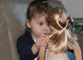 Small Child Plays with her Doll Royalty Free Stock Photo