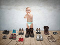 Small child and shoes a lot of old Royalty Free Stock Photo