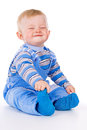 A small child sits and laughs Stock Images