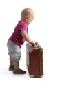 Small child standing next to suitcase white background isolated Royalty Free Stock Photo
