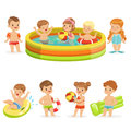 Small Children Having Fun In Water Of The Pool With Floats And Inflatable Toys In Colorful Swimsuit Collection Of Happy