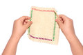 Small children s hands holding an embroidered napkin Royalty Free Stock Photo