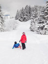 Small children in snow with sledges Royalty Free Stock Image
