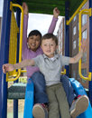 Small childs on slide. Royalty Free Stock Photo