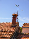 Small chimney on the roof of red tiles Stock Photography