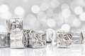 Small Christmas gifts in shiny silver paper Royalty Free Stock Photo