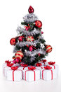Small christmas tree with lots of presents in white gift boxes isolated Royalty Free Stock Image
