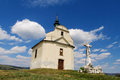 Small church on a green hill Royalty Free Stock Photo