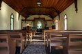 Small church interior of cozy rural Stock Photos