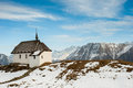 Small church with mountain panorama Royalty Free Stock Photos