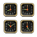 Small clocks showing various time of the day Royalty Free Stock Photo