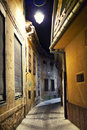 Small cobblestone alley pedestrian in city at night Stock Photos