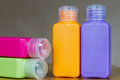 Small colored plastic bottles for traveling Royalty Free Stock Photo