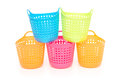 Small and colorful baskets stack up on white background Royalty Free Stock Photo