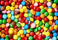 Small colorful candy on a black background. Royalty Free Stock Photo