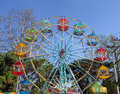 Small colorful ferris wheel open amusement park Royalty Free Stock Image