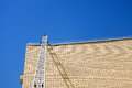 Small construction elevator on the building electric crane or lifter brick wall Royalty Free Stock Photo