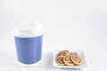 Small cookies on plate with take home paper coffee cup Royalty Free Stock Photos