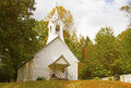 A small country church in fall with steeple Royalty Free Stock Photo
