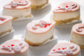 Small Cream and Raspberry Party Cakes Royalty Free Stock Photography